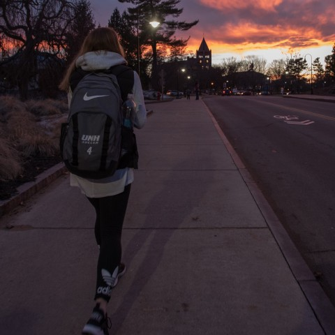 UNH student walking on campus